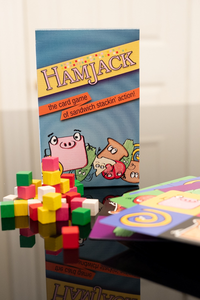 HamJack game with cubes and cards in front of the box.
